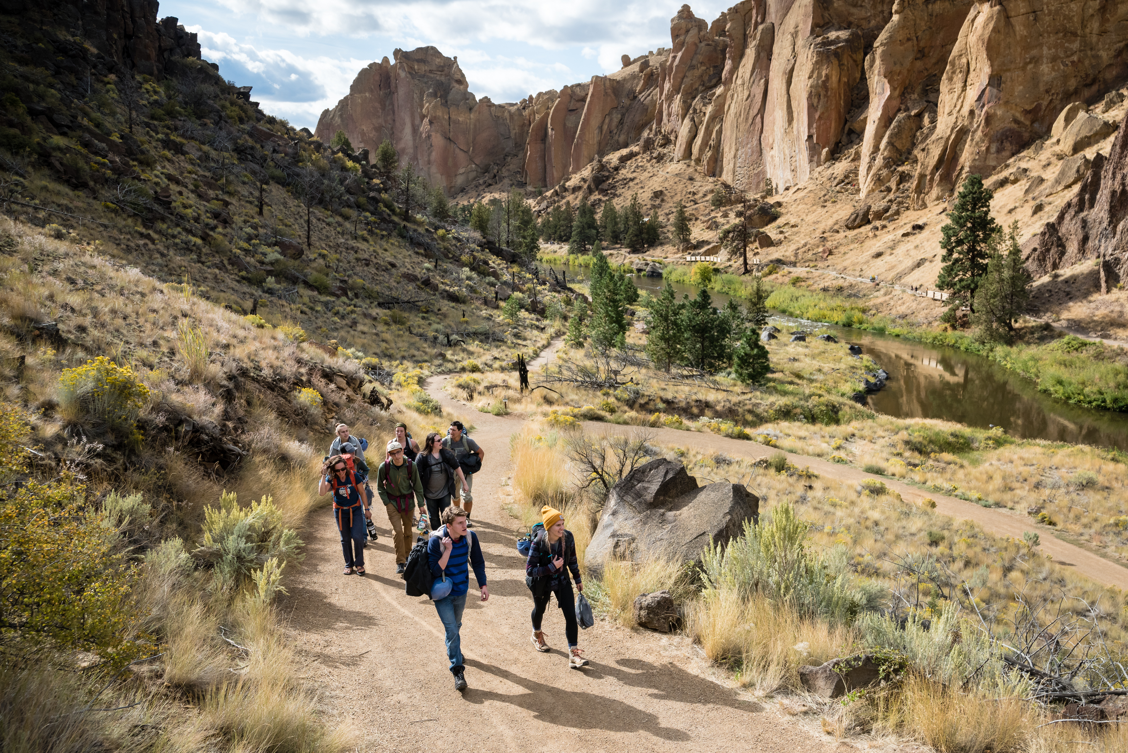 OSU-Cascades students and trip leaders hike out after rock climbing during the Headwaters Central Oregon Experience Trip at Smith Rock State Park on Friday, September 20, 2019.